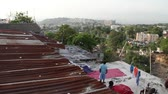 бедность : pan from tin roofs to wide shot of Port-au-Prince Haiti