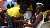 terremoto : young Haitian child  receives vaccine shot