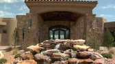 wealthy : large desert home with waterfall Stock Footage