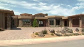 wealthy : large desert home with circular driveway