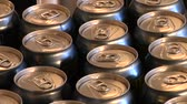 техника : close-up of beer cans on the assembly line