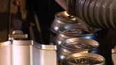 техника : close-up of  beer cans on assembly-line
