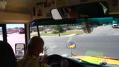 motorista : Shot of schoolbus driver looking and turning