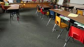 образование : Pan up of empty elementary school classroom