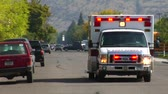 rescue : Ambulance with lights driving down street Stock Footage