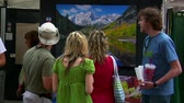 malarstwo : people admire painting at arts Festival