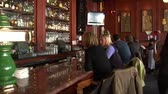 taberna : waitress carries martinis on trays through bar Stock Footage