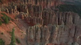 penhasco : aerial shot of Bryce Canyon national Park passing low over red spires