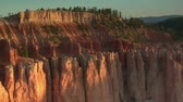penhasco : aerial shot of Bryce Canyon national Park zoom out from red spires Stock Footage