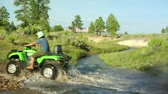 pullout as ATV riders cross stream