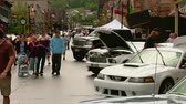summer vacation : spectators at Mustang car show Stock Footage