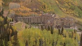 wzrost : tilt up to reveal large hotel in autumn forest
