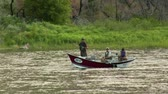 rybář : a three men in flyfishing trip boat paddle to stay stationary