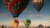 jezera : multiple hot-air balloons ascend into the sky