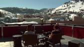 luksus : people enjoy sunny  winter weather on the rooftop in Park city Utah