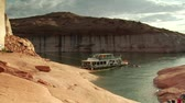 summer vacation : houseboat moored to red rock in Lake Powell Canyon