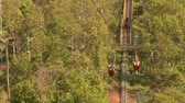 faaliyetler : A father and son go down a mountain zipline