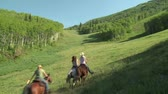 свобода : three young women on horses gallop across green meadowâ€by camera