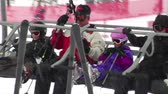 faaliyetler : Family gets settled on chairlift, skiiers in back