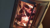Firewood burning in a livingroom fireplace - angular closeup Stock Footage