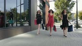 farra : Three wonderful female friends walking down the street and talking to each other
