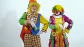 цирк : Two comic circus clowns dancing synchronously