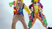 psychopath : Close-up of jumping clowns dressed in colorful and funny costumes Stock Footage