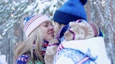 Romantic young couple kissing and enjoying their time in the winter forest Stok Video