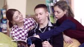 stupeň : Portrait of three students enjoying the book they are reading Dostupné videozáznamy