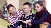 referência : Two girls and a boy studying the book together