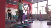 ginástica : Step group training, smiling people doing exercise Stock Footage