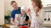 chopped : A beautiful family is preparing a delicious fruit salad in the kitchen of the house. Stock Footage