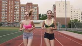 rivalry : Portrait of two young athletes who compete in the race at the stadium in the morning, summer, outdoors Stock Footage