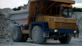heavy : Heavy mining dump truck being loaded with iron ore