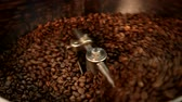 Roasting coffee beans on a large frying pan Stock Footage