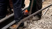 sleepers : Railway workers bolting track rail