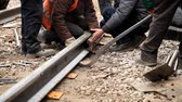 high up : Railway workers bolting track rail