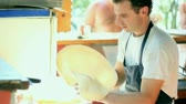 meal : Montage of clips showing skillful chef preparing a pizza. HD 1080i. Stock Footage