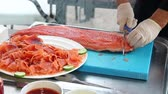 cutting in : Chef Slicing Smoked Salmon Fish