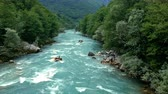 empolgante : Aerial Drone Shot of People White Water Rafting on River