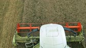 Flying Close Above the Agricultural Combine Harvester