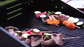 Vegetables cooking on the barbecue Стоковые видеозаписи