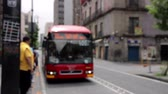 motorista : Mexico City, Mexico-June 2014: Bus stop blurred image, a bus arrive and open the door. At present Mexico City is changing the way to mobility in downtown. Making it more efficient.