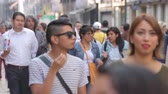 Mexico City, Mexico-CIRCA June,2017 : Crowd walking through street. In Mexico the populatIon growing is a public problem due the high birth rates. Stok Video