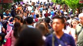 sestup : CHIAPAS, MEXICO-CIRCA AUGUST 2018 (SLOW MOTION): Tourists and local people walking in the street in San Cristobal de las Casas. TAKE 2