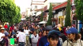 CHIAPAS, MEXICO-CIRCA AUGUST 2018: Tourists, indigenous and local people walking in the street in San Cristobal de las Casas. TAKE 4