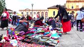 medeniyet : CHIAPAS, MEXICO-CIRCA AUGUST 2018: Merchant indigenous women offer traditional clothes to the tourists in the public square in San Cristobal de las Casas. TAKE 1 Stok Video