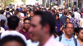 Mexico City, CIRCA June 2018 SLOW MOTION-TAKE 11: Crowd walking through street. In Mexico the population growing is a public problem due the high birth rates.