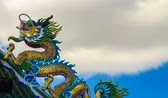 progeny : Time lapse golden dragon statue on the roof of the public chinese shrine Stock Footage