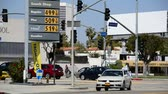 caro : High Gas Prices - LOS ANGELES - APRIL 15: Shell station sign displays high gas prices on April 15, 2012 in Los Angeles, CA.